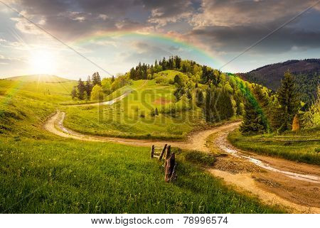 Cross Road On Hillside Meadow In Mountain At Sunset