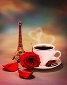 Photo of breakfast in Paris, beautiful morning in France, romantic still life, cup of coffee with piece of chocolate and fresh red rose on the table in cafe, honeymoon travel, Valentine day  poster