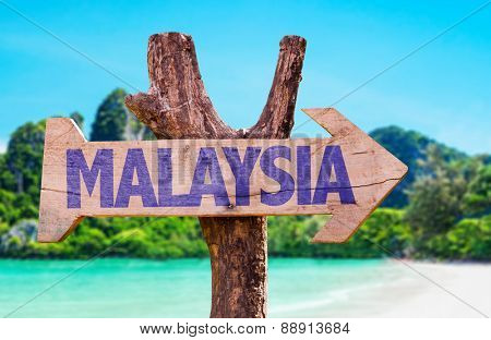 Malaysia wooden sign with beach background