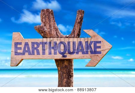Earthquake wooden sign with beach background