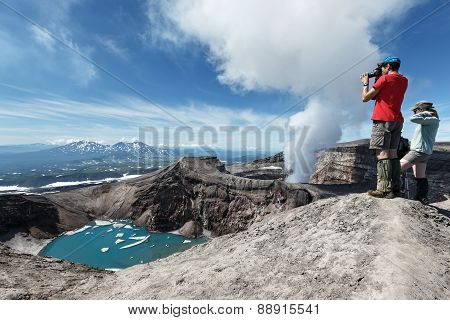 Tourists In Crater Of Active Gorely Volcano Takes A Picture. Russia, Kamchatka