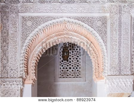 Arabesque Carved Plaster Above An Archway In  A Moroccan Medersa