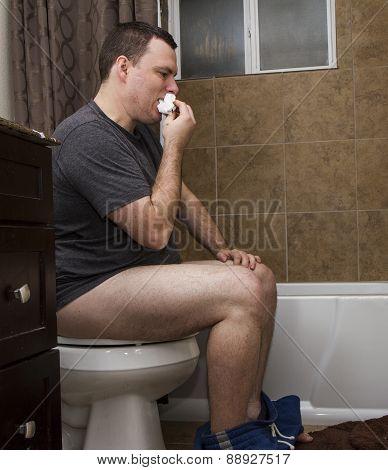 Man Eating Toilet Paper.