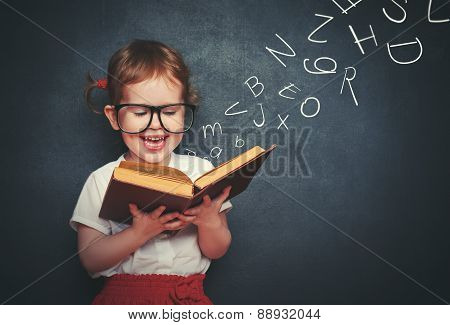 Little Girl With Glasses Reading A Book With Departing Letters