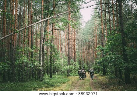 Unidentified reenactors dressed as German soldiers during march in forest