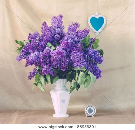 Lilac In A Vase And Small Heart-shaped Mirror