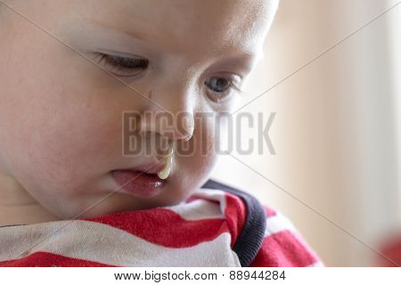 Toddler With Snot Hanging Out Of Nose