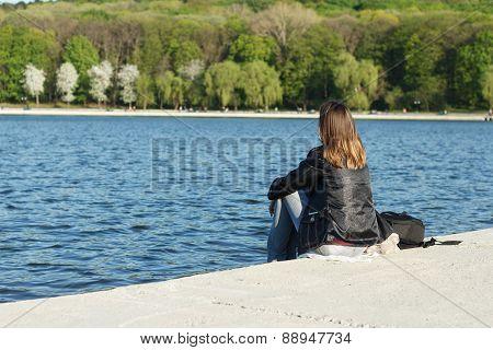 Girl Meditates On Bank