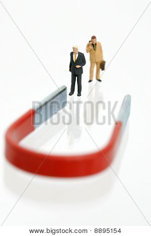 Two businessmen with magnet