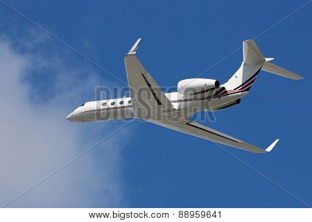 Private corporate business jet in flight