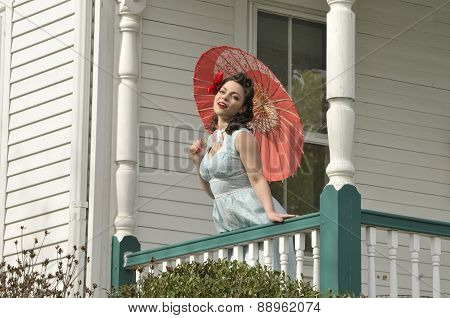 Retro Pin Up Girl With A Red Parasol