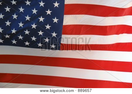 Large American Flag Lit By Sun