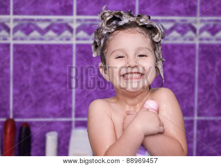 Child with foam in hair smiling