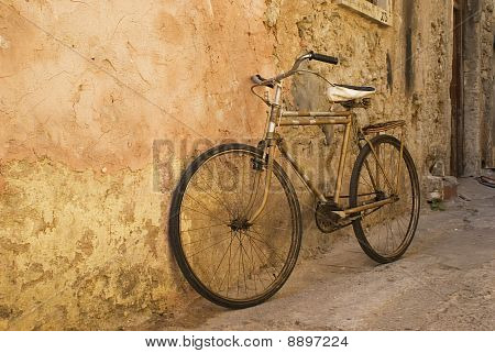 Old Bicycle At A Wall