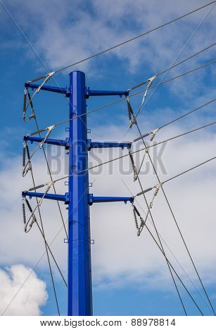 Blue Transmission Tower and Power Lines