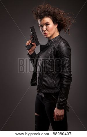 Sexy military, killer woman posing with gun. With dirty face, blood and wound. poster