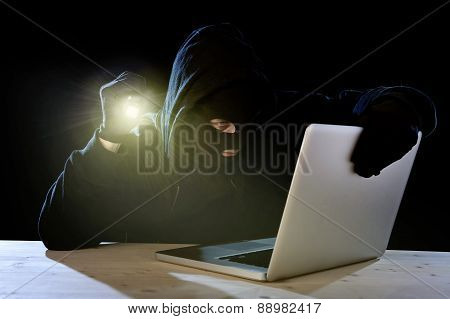 Expert Hacker With Computer Laptop Holding Flashlight Hacking System