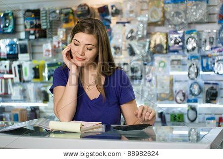 Woman Computer Shop Owner Examining Bills And Taxes