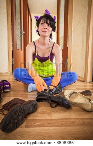 housewife sits on a floor and cleans footwear poster