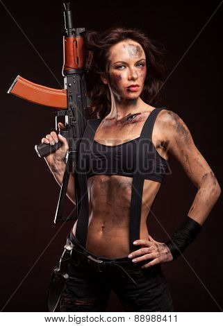 Sexy blond woman killer holding automatic gun