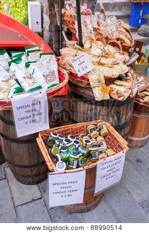 RIOMAGGIORE, ITALY - APRIL 12, 2015: Traditional italian food on the market of Riomaggiore in Italy. Riomaggiore is one of five famous coastline villages in the Cinque Terre National Park.