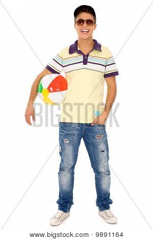 Young man holding beach ball