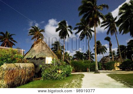 AITUTAKI, COOK ISLANDS - SEP 20: Traditional Polynesian houses at night on Sep 20 2013. It's one of the only places in Cook Islands that Kika huts still exist as it's considered inferior to European architecture.