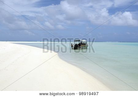 "Small cruise boat with tourists. Steve Davey Wrote in his book ""Unforgettable Places to See Before You Die"" that Aitutaki lagoon is the most beautiful in the world. poster"