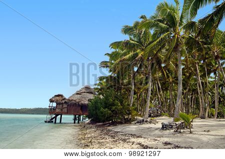 Reef Bungalows over tropical coral reef in tropical pacific ocean Island.