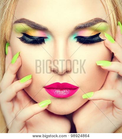 Beauty Woman face Portrait with Vivid Makeup and colorful Nail polish. Colourful nails. Fashion Girl close up. Bright Colors. Manicure Make up. Smoky eyes, long eyelashes. Rainbow Colors