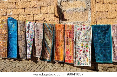 Handloom traditional and colorful clothes hanging Golden Fort of Jaisalmer Rajasthan India with copy space