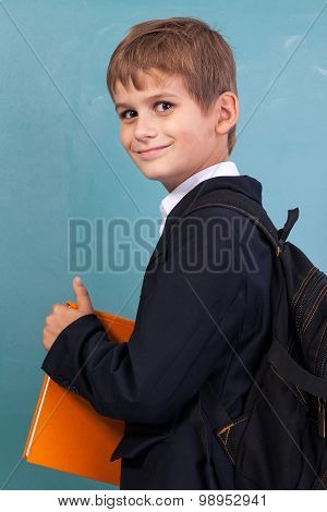 ?ute Schoolboy Is Holding An Orange Book