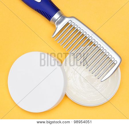 Hair wax with a comb on bright yellow background poster