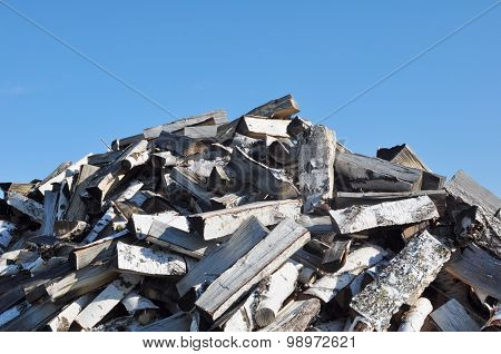 Pile of Firewood and Blue Sky