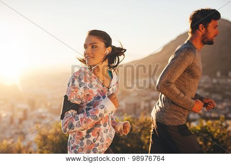Young Woman Looking Back While Running
