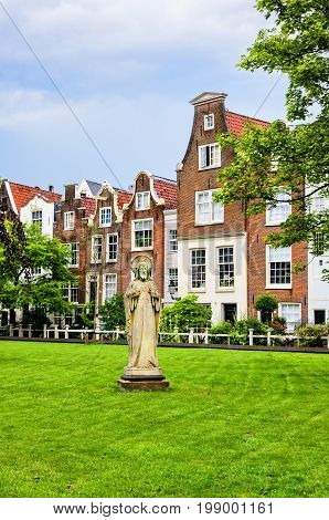 Amsterdam Netherlands - July 14 2017: Section of the Begijnhof an enclosed courtyard dating from the 14th century and a sactuary for a Catholic sisterhood who lived like nuns.