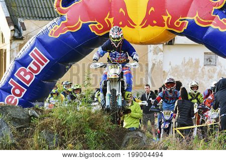 Sibiu, Romania - July 16: Unknown Competitor In Red Bull Romaniacs Hard Enduro Rally With A Ktm Moto