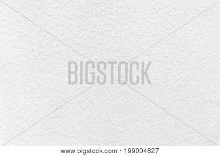 Texture of old light white paper background closeup. Structure of dense cream cardboard.
