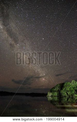 Long-exposure Night Sky and the Milky Way over the Amazon Rainforest. Brazil