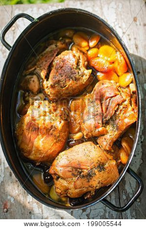 Turkey breasts roasted with dried plums and apricots in gravy