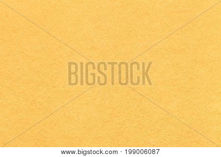 Texture of old light yellow paper background closeup. Structure of dense lemon citron cardboard