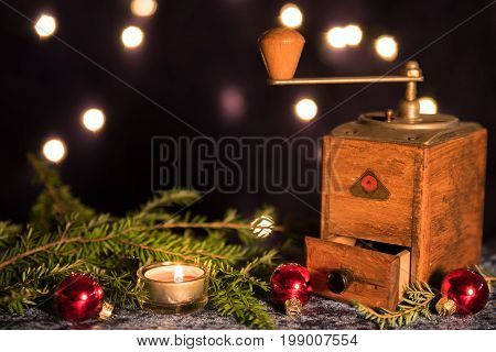 Christmas with old coffee grinder and candlelight