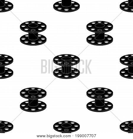 Metal reel for threads.Sewing or tailoring tools kit single icon in black style vector symbol stock web illustration.