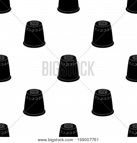 A thimble to protect your fingers when sewing.Sewing or tailoring tools kit single icon in black style vector symbol stock web illustration.