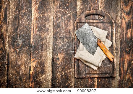 Serving Background. Old Hatchet On A Chopping Board.