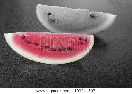 Sweet watermelon black and white slice and color one on the board