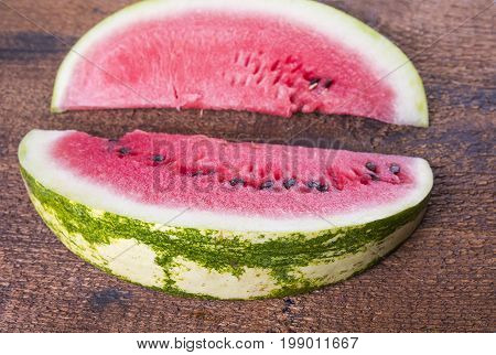 Two seet watermelon slices on the wooden board