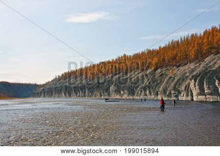Fishing and fishermen with their boat on the Siberian taiga river in the fall. Moiyero river Evenkia Krasnoyarsk region Russia