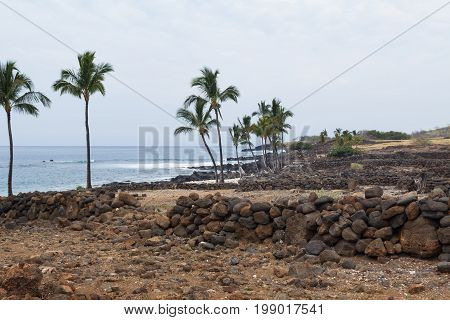 Shoreline and rock walls of Lapakahi State Historical Park an old viallage on the Big Island of Hawaii.