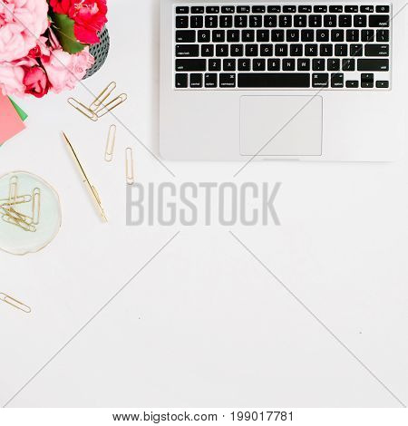 Flat lay home office desk. Female workspace with laptop pink and red roses bouquet golden accessories on white background. Top view feminine background.